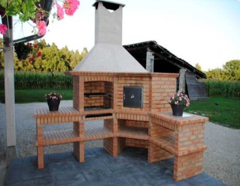 image of barbecue and wood fired oven